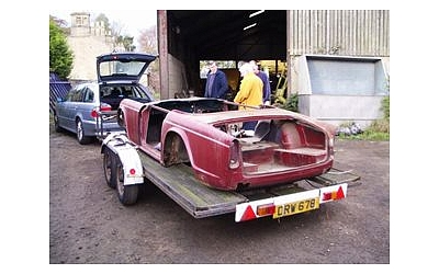 Daves Rally TR4, a ground up rebuild. New 'Old' Shell on its way to its new home