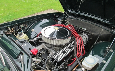 Rover V8 powered TR6 - note custom alloy covers!
