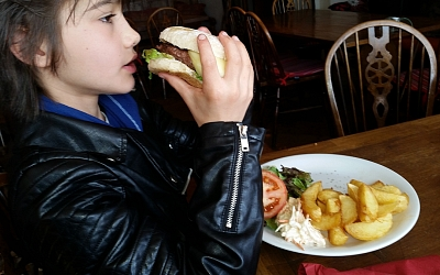Dave Burgess's grandson tucking into a hearty burger!