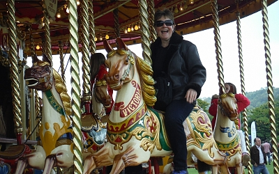 Heather enjoys a ride on the steam driven gallopers