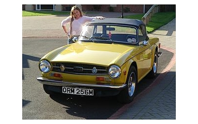 Megan, Daves daughter proudly shows off their TR6 which is on the road and currently receiving go faster engine mods