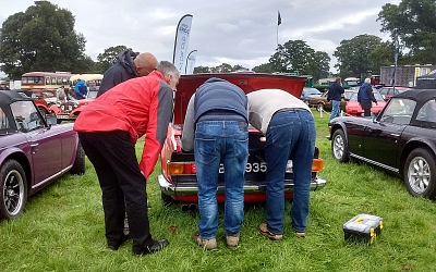 Alec getting some assistance with a rear end problem..