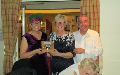 Jeanna and Nigel Ind presented with the Group Leader's Award by newly elected Group Leader Lesley Swain