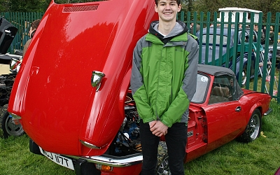 The next generation of classic car enthusiast. Andrew's Spitfire as shiny as Dad's Alpine!