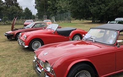 Chris's TR4 looking fearless in spite of the all red opposition in the Masterclass category