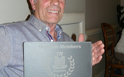 Steve Craig receives a plaque to commemorate his 70th birthday.