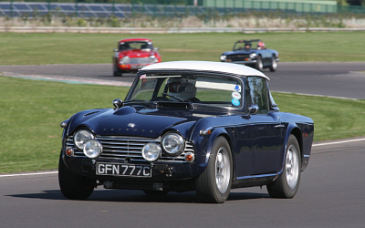 Dave at Castle Combe with Richard in hot pursuit.