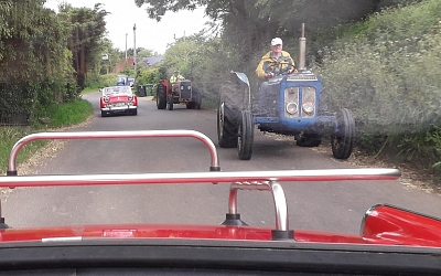 Running alongside a giant vintage tractor convoy