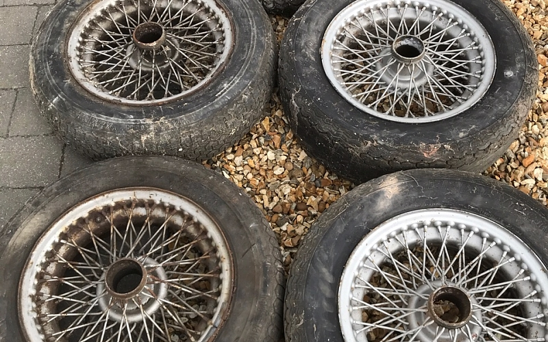 Three used original wheels and two rebuilt wheels that have been used after the rebuild.