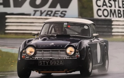 Darrel is let loose in Len's TR4. Photo courtesy of Jim Gaisford.