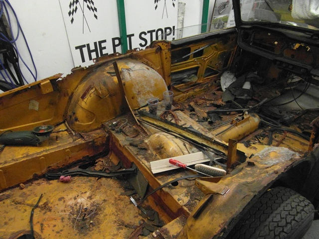 TR6 CP 1970 (11) removal of rear deck, support frame, mountings and boot hinges.
